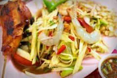 Roast chicken and Papaya salad.  royalty free stock image
