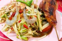 Roast chicken and Papaya salad. The Roast chicken and Papaya salad stock photos