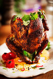 Roast Chicken on a Plate with Herbs and Spices Royalty Free Stock Image