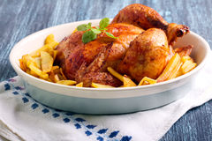 Roast chicken and potato chips Royalty Free Stock Photography