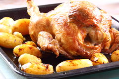 Roast chicken and potato A Royalty Free Stock Images