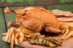 Roast Chicken with potato Stock Image