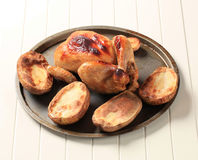 Roast chicken and potatoes Royalty Free Stock Photos