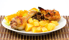 Roast chicken with potatoes Stock Photo
