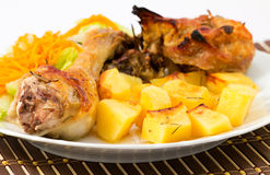 Roast chicken with potatoes Royalty Free Stock Photo