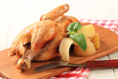 Roast chicken and potatoes Royalty Free Stock Images