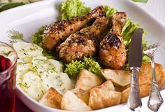 Roast chicken with potatoes and cucumber Royalty Free Stock Image