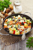 Roast chicken with potatoes and mushrooms Royalty Free Stock Photo
