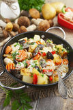 Roast chicken with potatoes and mushrooms Royalty Free Stock Images
