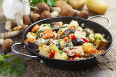 Roast chicken with potatoes and mushrooms Stock Photo