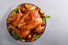 Roast chicken with roast potatoes and mushrooms. On plate stock images