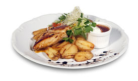 Roast chicken with potatoes and  vegetables on a p. Roast chicken with potatoes and Royalty Free Stock Photography