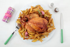 Roast chicken and potatoes on the white table Stock Image