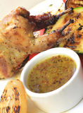 Roast chicken, quail on a platter Stock Photo
