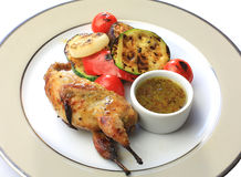 Roast chicken, quail on a platter Stock Images