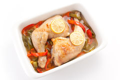 Roast chicken with red and green peppers Royalty Free Stock Photos