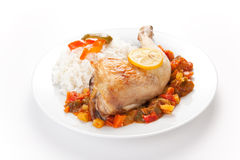 Roast chicken with red and green peppers Stock Images