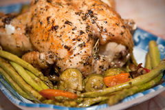 Roast chicken with roasted asparagus Stock Photography