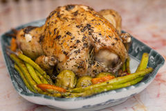 Roast chicken with roasted asparagus Stock Image