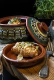 Roast chicken rolls in rustic stoneware bowl stock photos