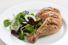 Roast chicken with salad. Roast chicken thigh with salad stock image