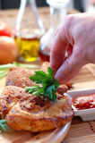Roast chicken with sauce. On a dining table close up Stock Photography