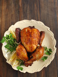 Roast chicken seasoned  with herbs and lemon Royalty Free Stock Photos