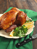 Roast chicken seasoned with herbs and lemon Royalty Free Stock Photo