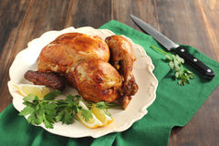 Roast chicken seasoned with herbs and lemon Royalty Free Stock Image