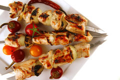 Roast chicken shish kebab on white Stock Images