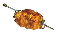 Roast chicken on skewer. Isolated on white background Stock Image