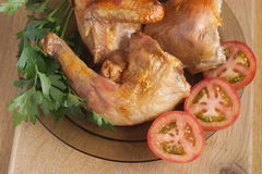 Roast chicken with sliced tomatoes and herbs Stock Photography