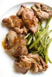 Roast chicken with string beans Stock Images