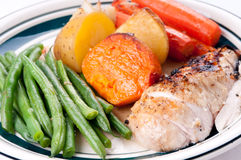 Roast chicken with sweet potato, carrots and beans Royalty Free Stock Photography