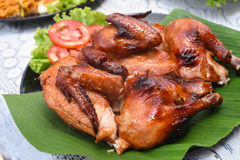Roast chicken. A Roast chicken on the table Royalty Free Stock Photos