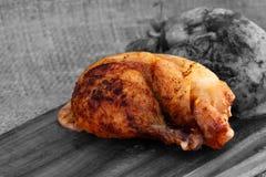 Roast chicken thigh chopping board Stock Photo