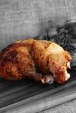 Roast chicken thigh chopping board Royalty Free Stock Photo