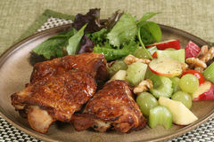 Roast chicken thighs with mixed salad Stock Photo