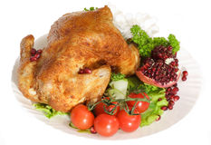 Roast chicken with tomatoes Stock Photography