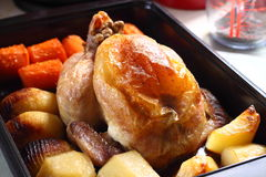 Roast chicken in tray A Stock Photo