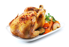 Roast chicken. And various vegetables on a white plate Royalty Free Stock Photo