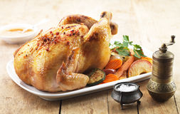 Roast chicken. And various vegetables on a white plate stock photos