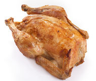 Roast chicken. On a white background Stock Photos