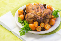Roast chicken on white and green Stock Photo