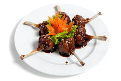 Roast chicken wings on a plate Stock Images