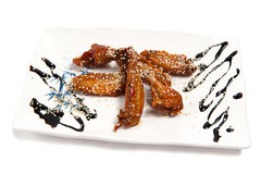 Roast chicken wings on a plate Royalty Free Stock Images