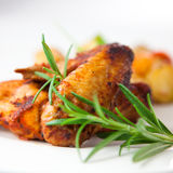 Roast chicken wings with rosemary. Close up of roast chicken wings with rosemary royalty free stock photos