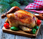 Roast chicken on a wooden table Royalty Free Stock Photo