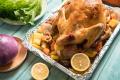 Roast chicken on the wooden table royalty free stock photography
