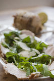 Roast chine of pork with arugula and parmesan Stock Images